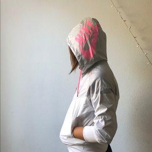 Pink-while-grey Nike windbreaker